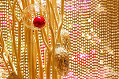 Beautiful Christmas decorations against a  golden beaded curtain Royalty Free Stock Images