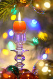 Beautiful Christmas decorations with burning candle. And Colored Light Royalty Free Stock Images