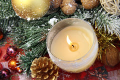Beautiful Christmas decorations with burning candle Stock Photos