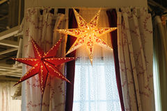 Beautiful Christmas decorations glowing star in the bedroom.  stock photos