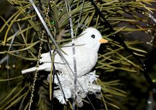 Beautiful Christmas decorations for home and Christmas trees. Beautiful Christmas decorations for the home and the Christmas tree, shiny birds, unusual balls Stock Photos