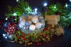 Beautiful Christmas decorations in the round glass. Spruce branches, light. candles and Christmas stocking.  stock images