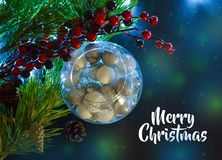 Beautiful Christmas decorations in a round glass. Spruce branches, light. And the inscription Merry Christmas. Top view royalty free stock photography