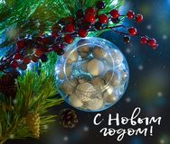 Beautiful Christmas decorations in a round glass. Spruce branches, light. And the inscription in Russian Happy New Year. Top view.  royalty free stock photos