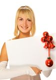 Beautiful Christmas elf. Holding a white noticeboard Stock Photography
