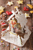 Beautiful Christmas gingerbread house and cookie close-up. verti Stock Photos