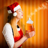 Beautiful christmas girl finishing cleaning chores Stock Photo