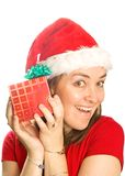 Beautiful christmas girl with a gift Royalty Free Stock Image
