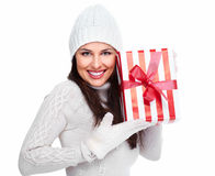 Beautiful christmas girl with a gift. Stock Image