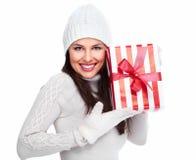 Beautiful christmas girl with a gift. Stock Image