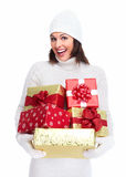 Beautiful christmas girl with a gift. Royalty Free Stock Image