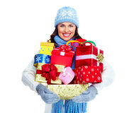 Beautiful christmas girl with gifts. Stock Photos