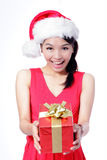 Beautiful Christmas Girl happy holding gift Stock Photos