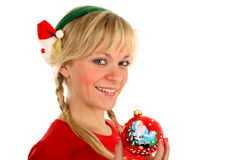 Beautiful Christmas girl holding in her hand toy Royalty Free Stock Image