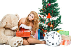 Beautiful christmas girl isolated white background near tree and toys Royalty Free Stock Photos