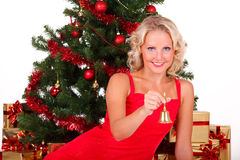 Beautiful Christmas girl in red Stock Images