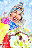 Beautiful christmas girl with shopping bags. Stock Images