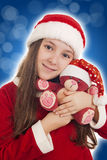 Beautiful Christmas Girl with teddy bear. On blue background stock image