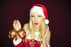 Beautiful Christmas girl with tree ornaments Stock Photo