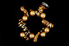 Beautiful christmas golden silver deco baubles on dark black background. royalty free stock photo