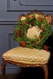 Beautiful Christmas green festive wreath from the Christmas tree lying on a chair Stock Image