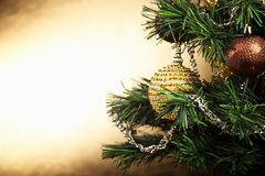 Beautiful Christmas green tree with yellow ball on the branches Royalty Free Stock Image