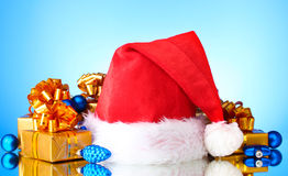 Beautiful Christmas hat, gifts Royalty Free Stock Photography