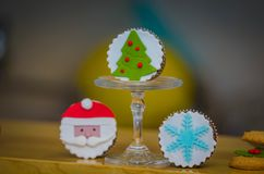 Beautiful christmas holiday muffins figurines. Beautiful christmas holiday muffins.Nice snowflakes.santa claus and christmastree muffins on the table Royalty Free Stock Photo