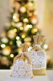 Beautiful Christmas interior decoration. Decoration element creative ideas with lace and linen on Christmas lights background Stock Photo