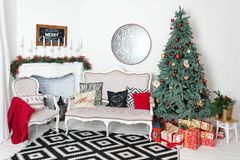 Beautiful Christmas interior. New year decoration. Comfort home. Classic new year tree decorated in a room with Stock Photo