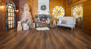 Cozy christmas interior with fir tree and fireplace Royalty Free Stock Photography