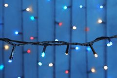 Beautiful Christmas lights on color background. Closeup royalty free stock photo