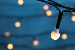 Beautiful Christmas lights on color background. Closeup Stock Photos