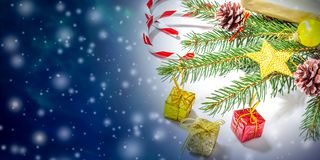 Beautiful Christmas and New Year`s background with Christmas tree branches, toys and sweets. stock photos