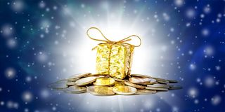 Christmas and New Year`s background with coins and gift box in gold packaging, falling snow and free space for text. Beautiful Christmas and New Year`s royalty free stock photo