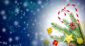 Beautiful Christmas and New Year`s background with Christmas tree branches, toys and sweets. stock images