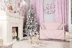 Beautiful Christmas nice pink interior. Concept of Merry Christmas and Happy New Year royalty free stock images
