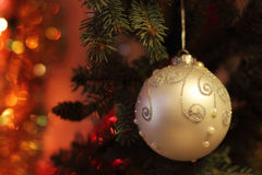Beautiful Christmas picture with Christmas tree and ball. New Years Eve celebration background with light Gold ball decorations. Bokeh gold garland on green Royalty Free Stock Photos