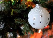 Beautiful Christmas picture with Christmas tree and ball. New Years Eve celebration background with white snow  ball decorations. Bokeh green  tree brunch Stock Image