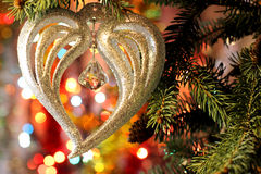 Beautiful Christmas picture with Christmas tree and New Years and Christmas Eve celebration background with a Heart decoration. Style New Years and Christmas Eve Stock Images