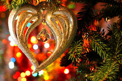 Beautiful Christmas picture with Christmas tree and New Years and Christmas Eve celebration background with a Heart decoration. Style New Years and Christmas Eve Royalty Free Stock Images