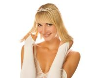 Beautiful Christmas princess. Beautiful blond girl with diamond diadem on her head isolated on white background Stock Photos