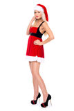 Beautiful christmas Santa girl in studio. Isolated on a white ba Royalty Free Stock Photography