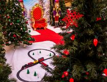 A Beautiful Christmas Setting Complete with Toy Train. A Christmas setting with a toy train, christmas trees, and Santa`s helpers Stock Photos