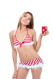 Beautiful christmas Sexy santa helper. Girl in red stripped bikini with red candle burning snowflakes  isolated on a white background Royalty Free Stock Image
