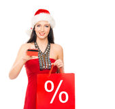 Beautiful Christmas shopper girl holding a business card Stock Images