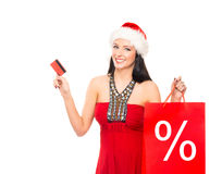 Beautiful Christmas shopper girl holding a business card Stock Photos