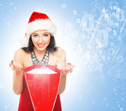 Beautiful Christmas shopper girl on a light blue background Royalty Free Stock Photo