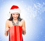 Beautiful Christmas shopper girl on a light blue background Royalty Free Stock Photography