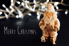 Beautiful christmas silver vintage garland and santa toy on styl Stock Photo
